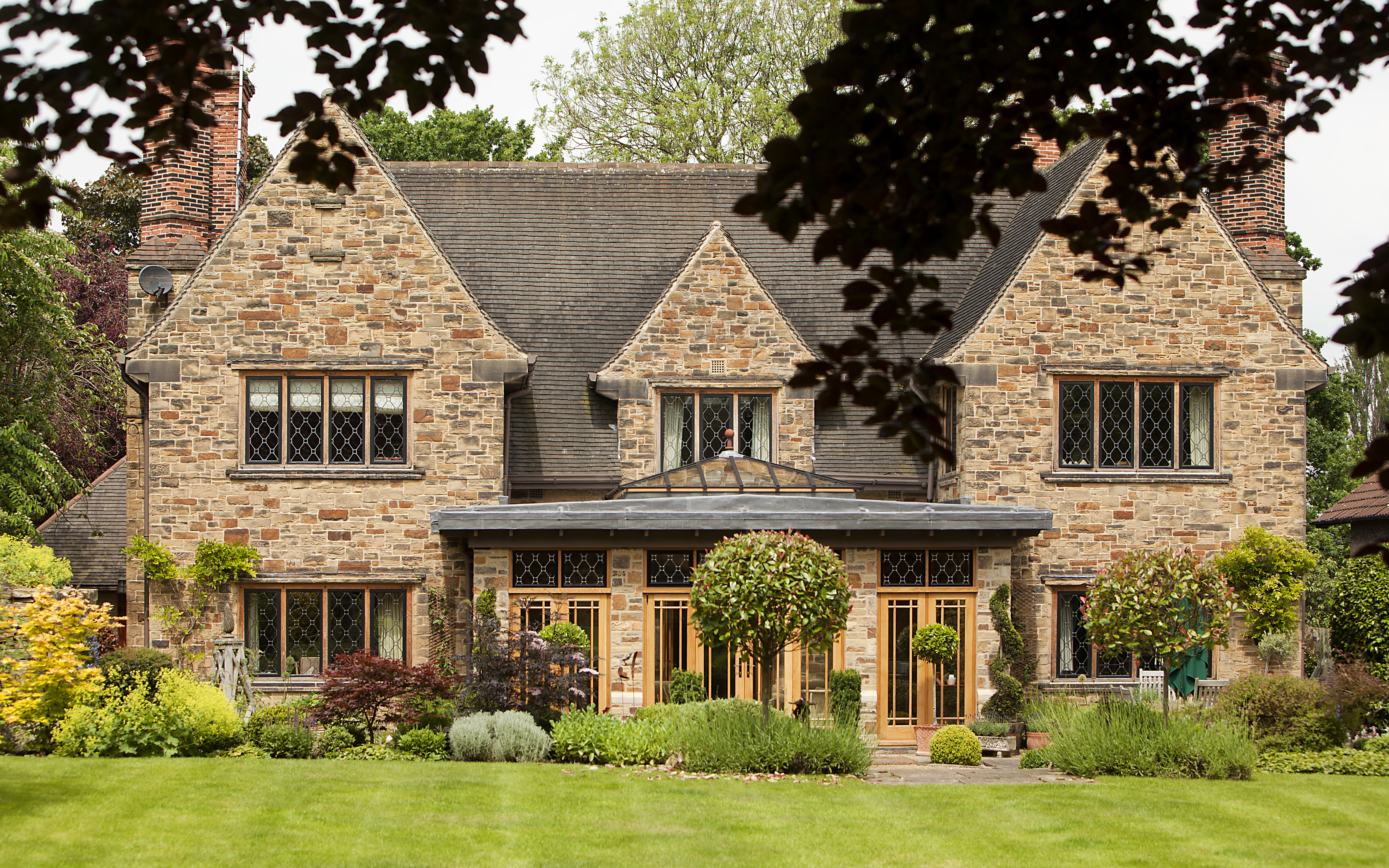 Stone fronted house with leaded metal windows