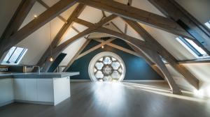 Metal windows wood beam attic loft