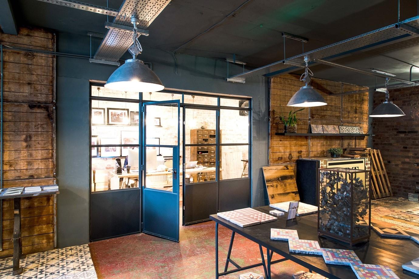 Steel screen and door in a workshop environment