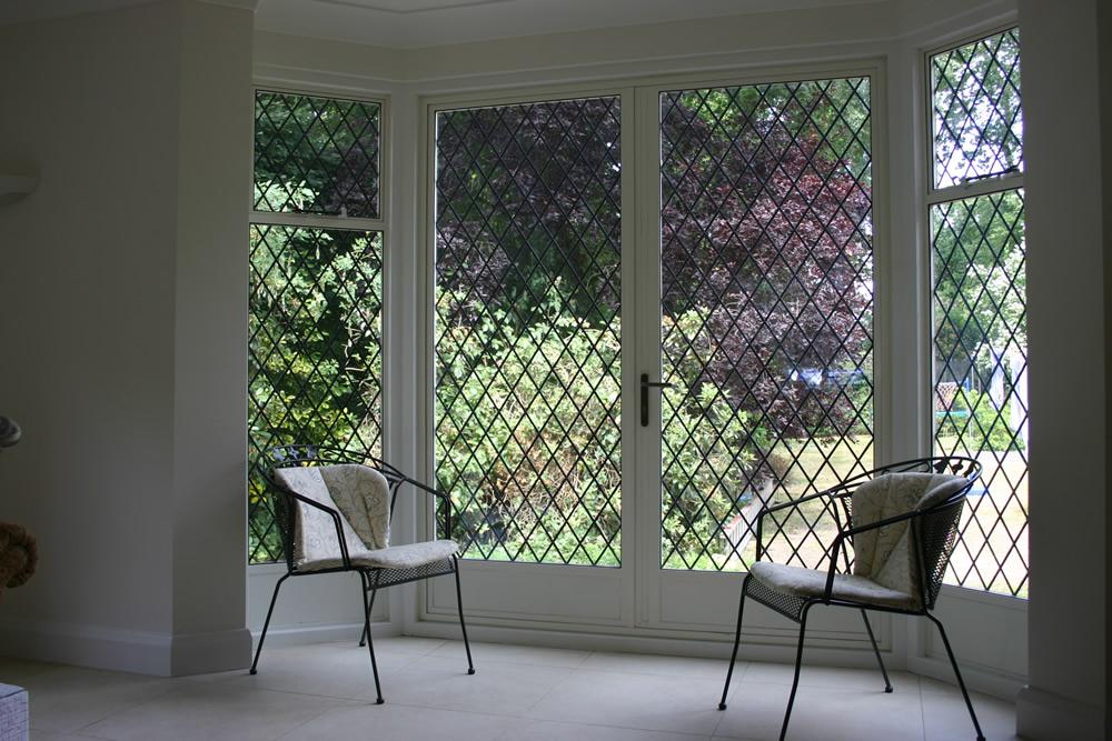 A view of the garden through steel windows